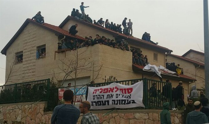 Protesters barricade themselves in house