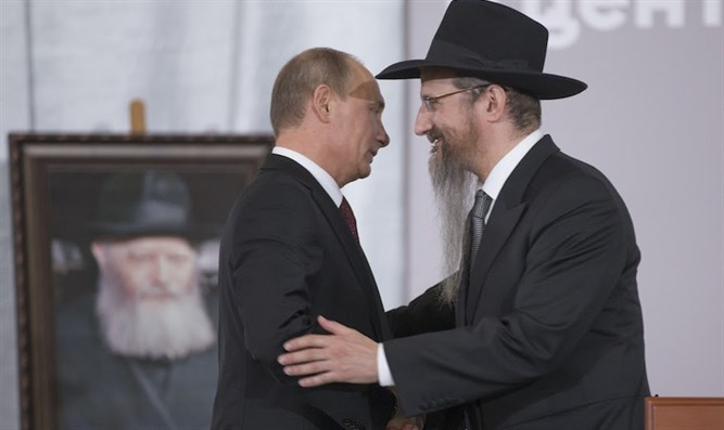 Russian President Vladimir Putin, left, is greeted by Russia's Chief Rabbi Berel Lazar