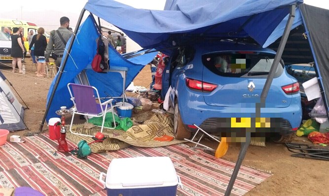 Car which crashed into tent