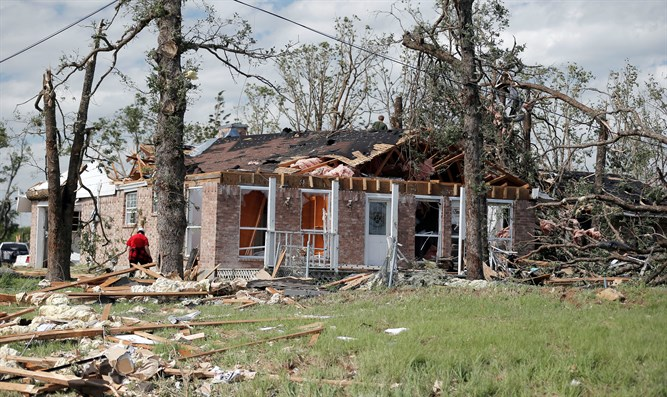 Homeowners after a tornado hit the town of Canton