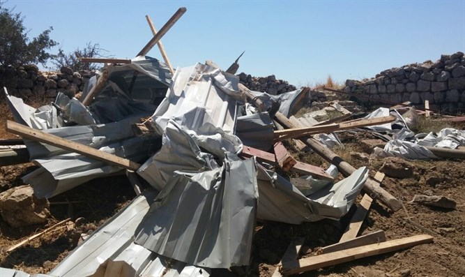 Destroyed structure in Amona