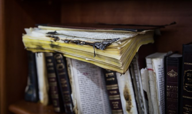 Partially burnt religious book in vandalized synaogue