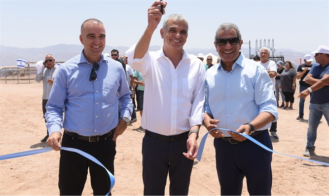 Cutting the ribbon at the EAPC beach ceremony on Wednesday