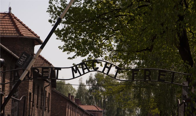 Poland jails Belarussians who stripped naked at Auschwitz, slaughtered lamb