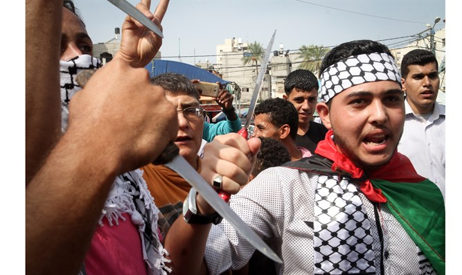 Palestinians in Gaza march in support of knife attacks