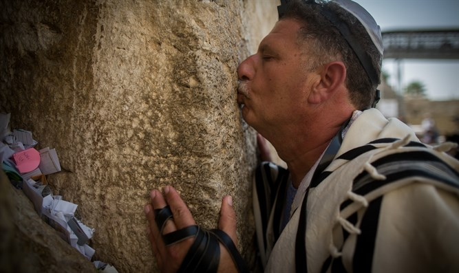 Worshipper kisses the Kotel