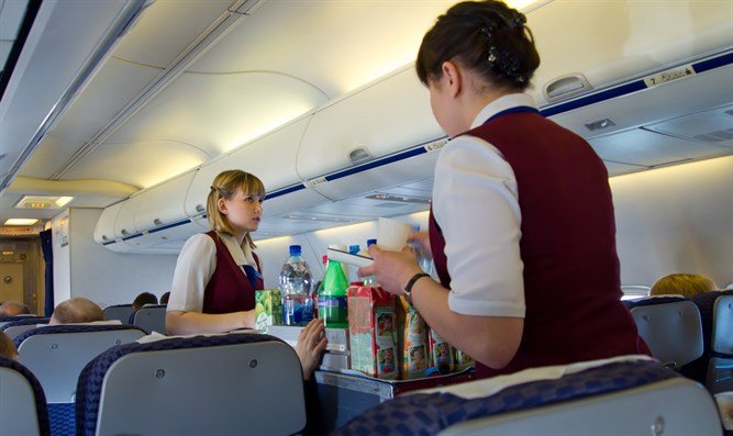 Serving refreshments on a plane