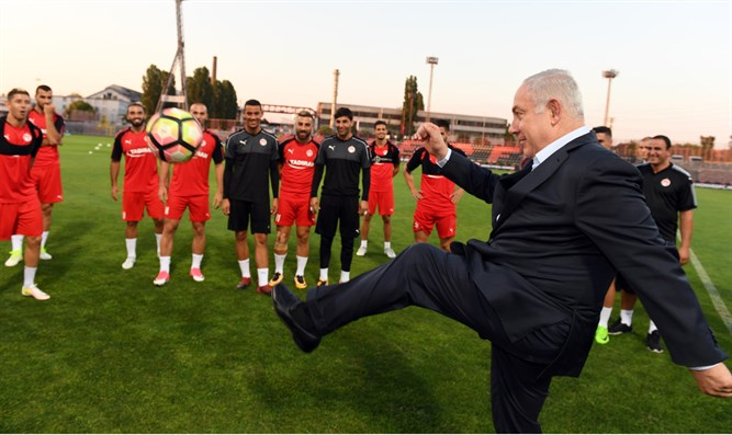 Netanyahu kicking the ball around