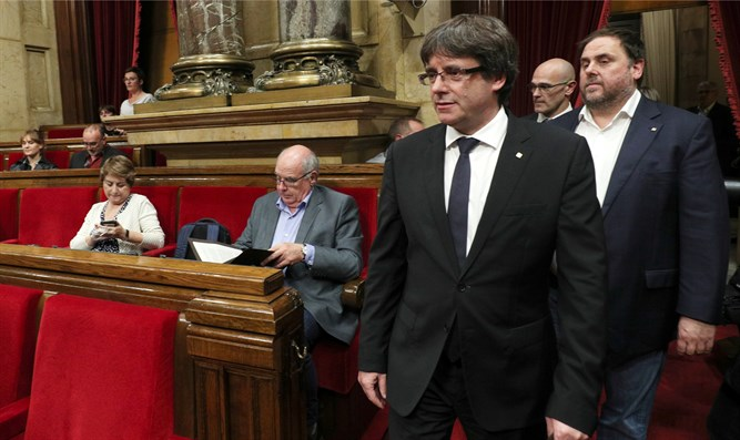 Catalan President Carles Puigdemont addresses parliament, today