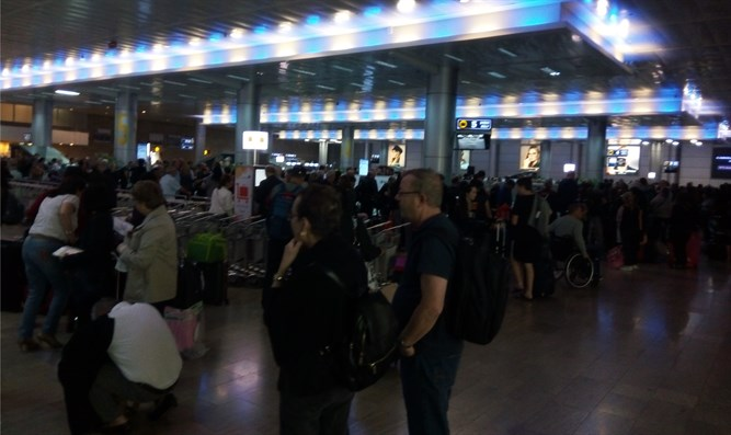 Passengers waiting for their luggage at Ben Gurion Airport