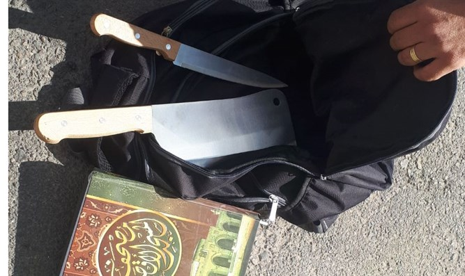 The terrorist's knife and Quran