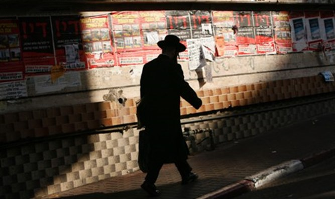 Man walks down street in Bnei Brak (stock)