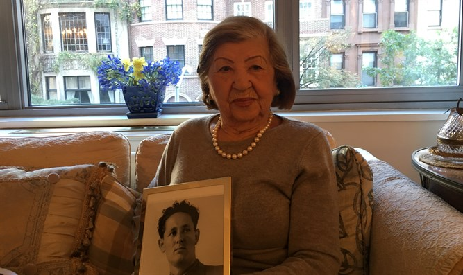 Rose Holm at her apartment holding a photo of her late husband, Joe