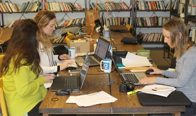 Women at work in the communal workspace of ICON.