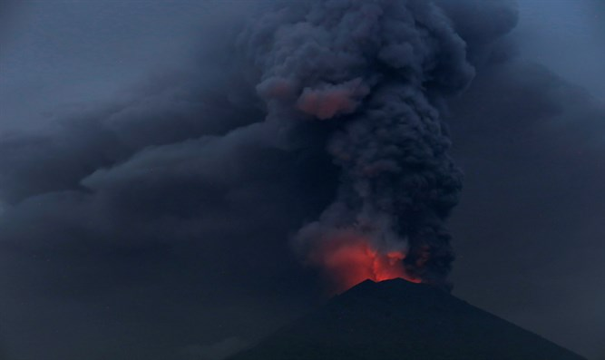 Glowing light of hot lava seen during eruption of Mount Agung as seen from Amed in Karanga