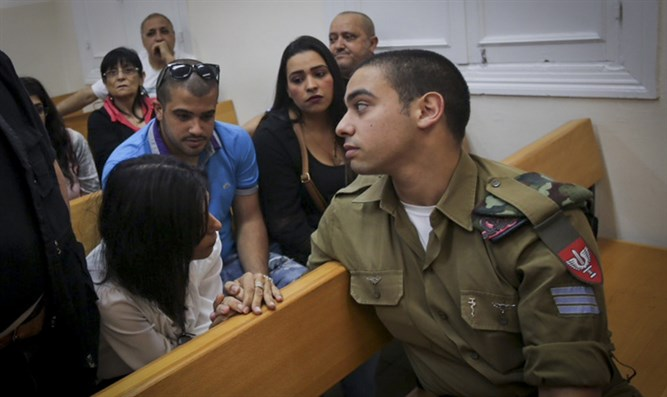 Elor Azariya in court with his family