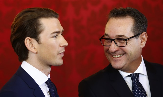 Austrian Vice Chancellor Strache of the FPOe smiles next to Chancellor Kurz