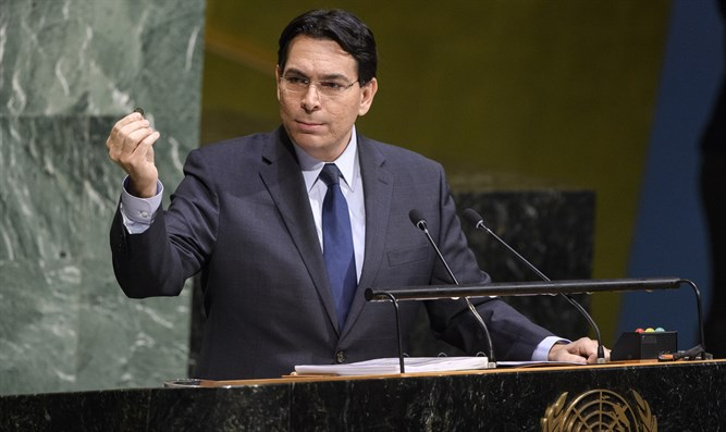 Danny Danon shows coin from Jerusalem