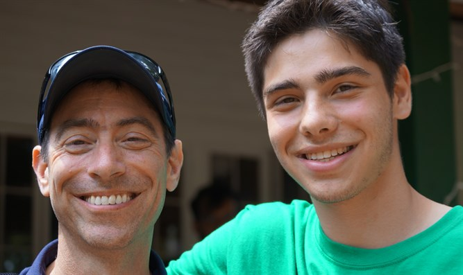 Bruce Steinberg, left, with son William at the Seeds of Peace Camp in Otisfield, Maine.