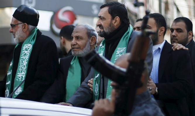 Senior Hamas leaders Emad al-Alami (R) and Mahmoud Zahar (C)