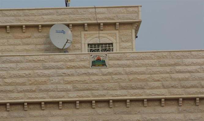 Al-Aqsa sign placed in the side of a Bedouin home