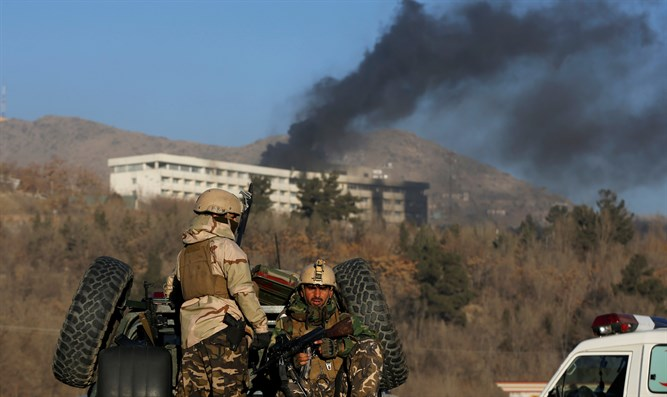 Afghan security forces outside of the Intercontinental Hotel in Kabul, following Taliban a