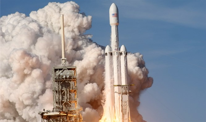 SpaceX Falcon Heavy rocket lifts off.