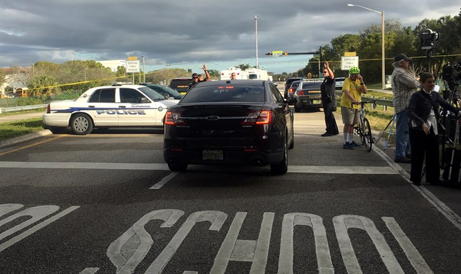 Police patrol near Marjory Stoneman Douglas High School