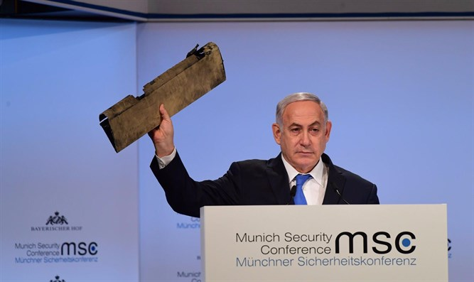 Netanyahu holding drone part