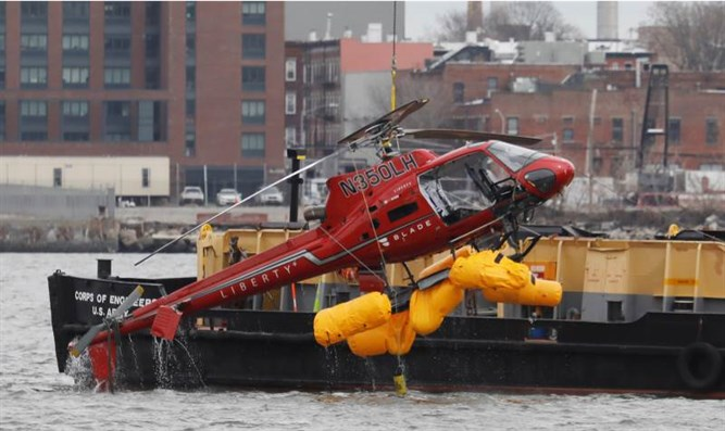 The helicopter being extracted from the water