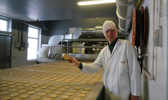Pieter Heijs showing one of the products of his Hollandia Matzes factory in Enschede.