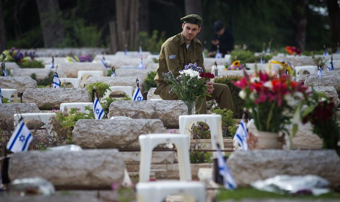 Soldier mourns at Mount Herzl military cemetery