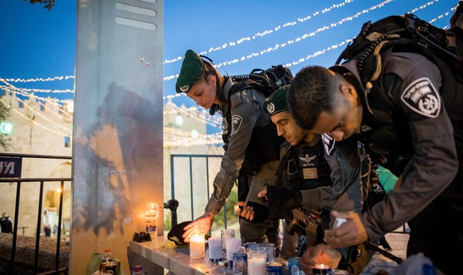 Border Police light candles for Hadas Malka