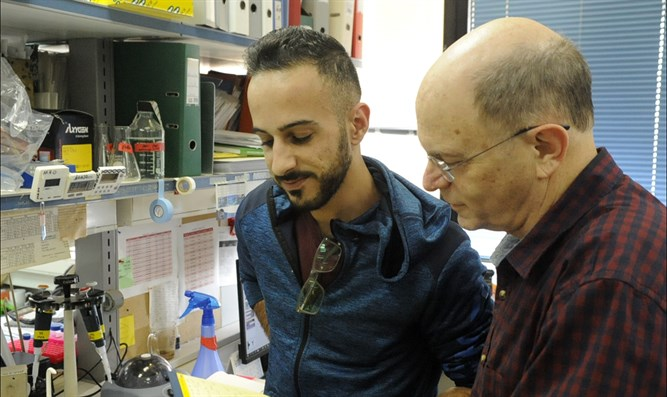 Dr. Yossi Shiloh, right, is a professor of human genetics at Tel Aviv University.