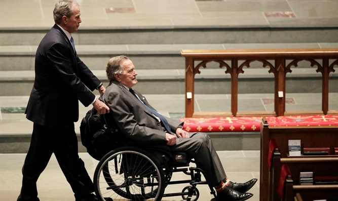(r)George W. Bush (l) and George H.W. Bush at Barbara Bush's funeral