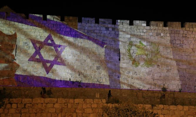 Guatemalan flag illuminated on Jerusalem walls