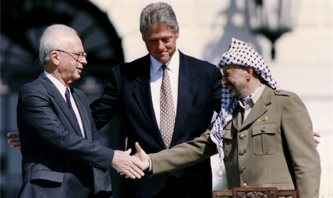 Arafat and Rabin shake hands after signing of Israeli-PLO peace accord