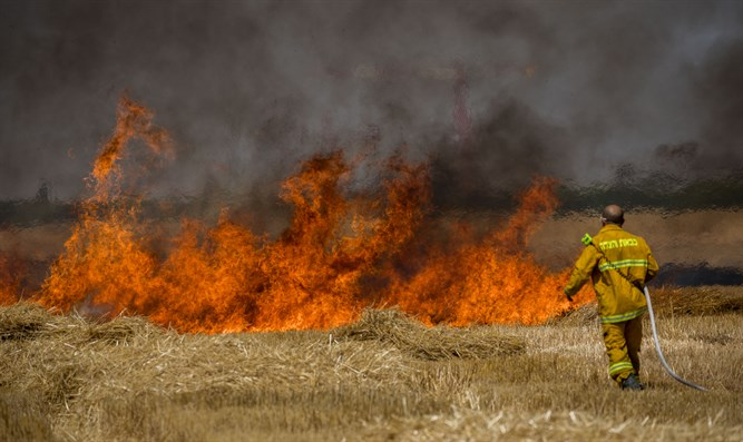 Firefighters work to put out kite fire near Gaza