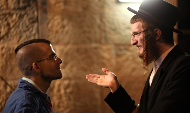 Haredi man speaks with secular man (illustrative)