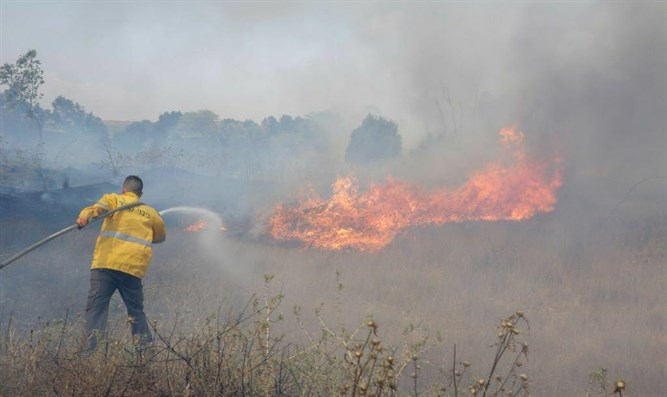 Putting out fires in Gaza area
