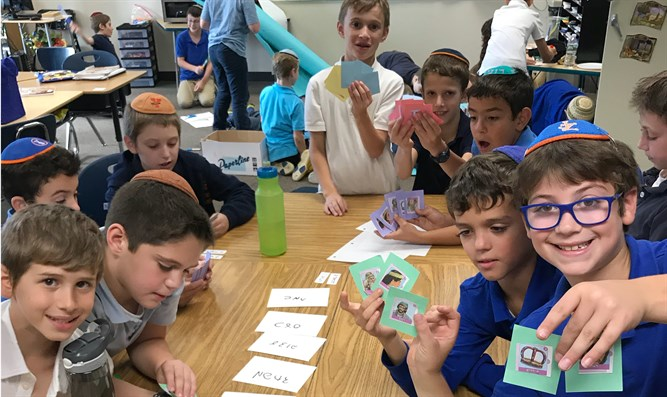 Fourth graders at Yeshivat Noam in New Jersey play a game involving the story of Joseph.