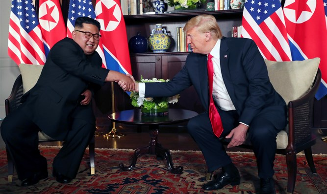 Donald Trump shakes hands with Kim Jong Un in Singapore