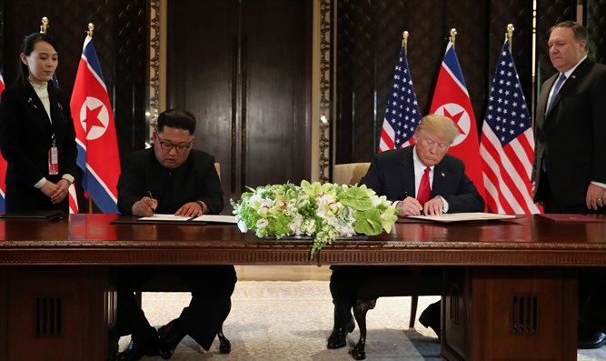 Kim, Trump sign agreement in Singapore