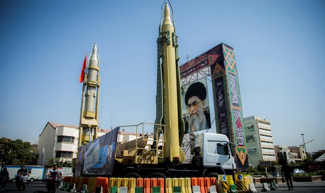 Display featuring missiles and portrait of Iran's Supreme Leader Khameni
