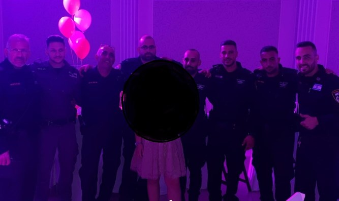Police officers celebrate with bat mitzvah girl