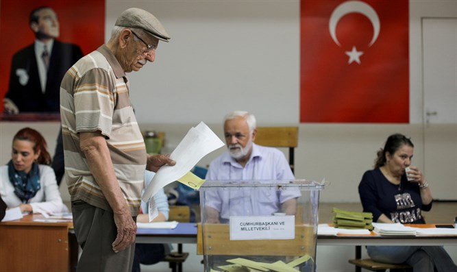 Man casts ballot for Turkey's presidential and parliamentary elections