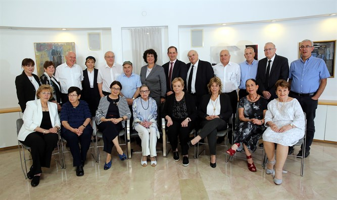 Ginsburg (center) received at Israeli Supreme Court