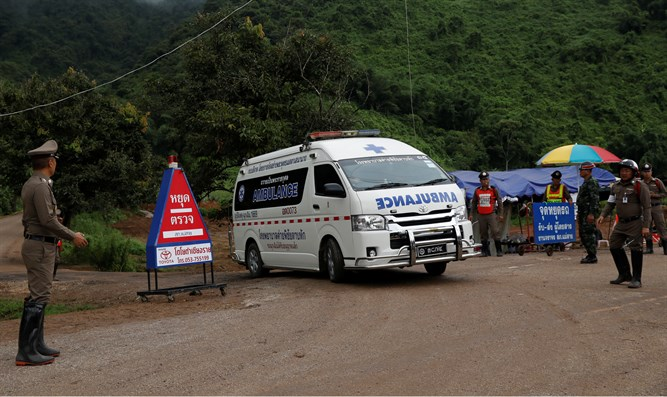 Rescue teams near entrance to flooded cave