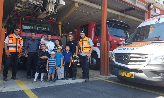 Hezki and his family with United Hatzalah volunteers at Rehovot's fire station