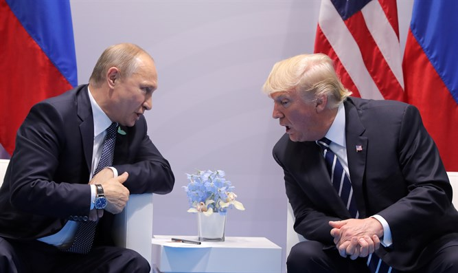 U.S. President Donald Trump speaks with Russian President Vladimir Putin